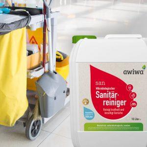 Bio Sanitärreiniger und Putzwagen im Hintergrund